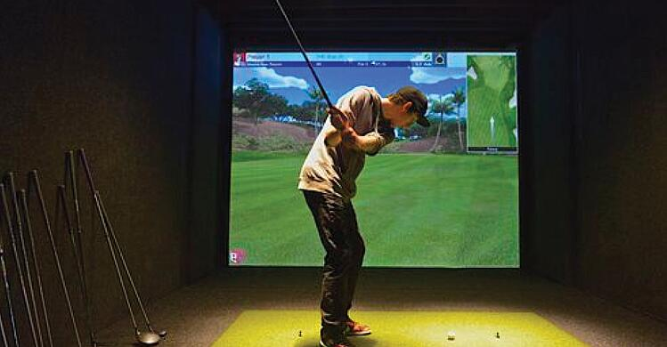 Golf simulator for year round golf practice, expansive option