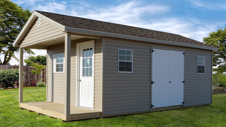 Pre built storage buildings ranch with porch dakota for Pre built porch